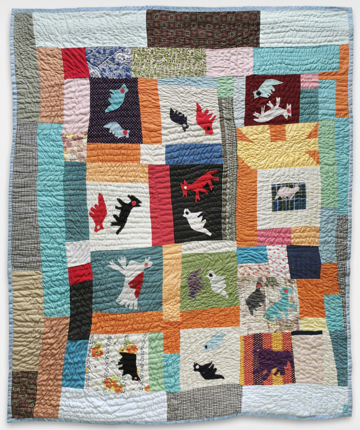 Image of a quilt, animal silhouettes and brightly colored blocks and rectangles.