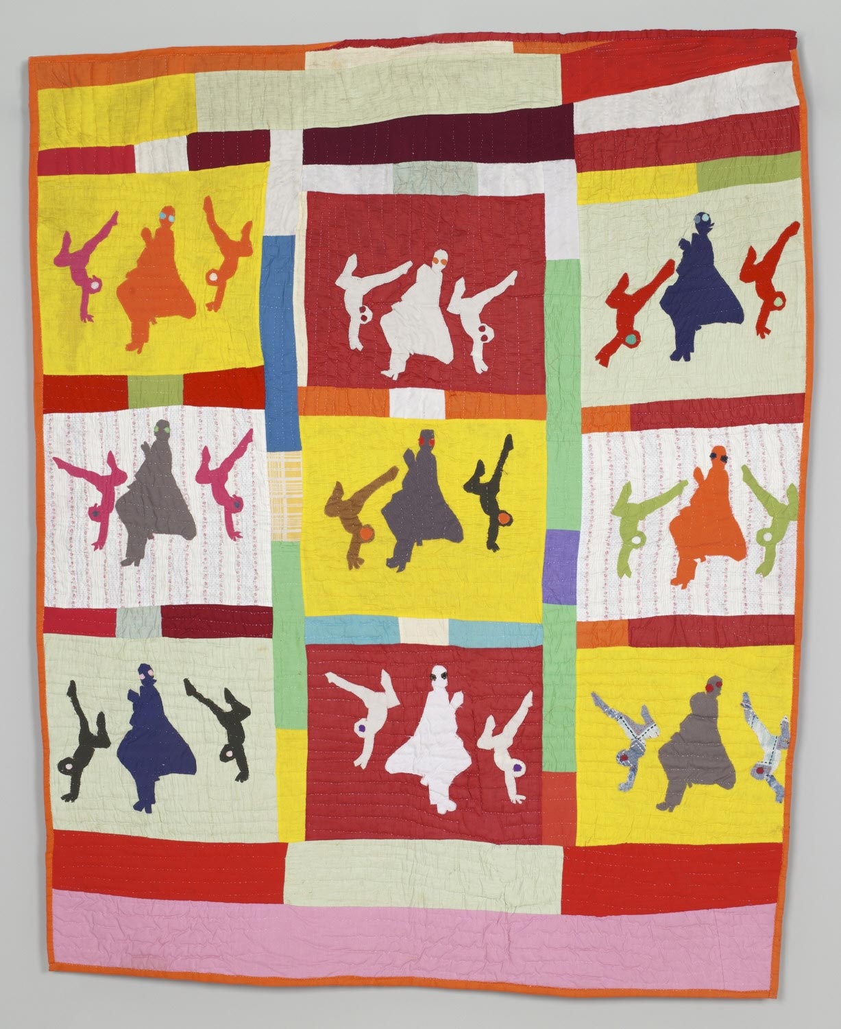Image of a quilt, shadow images of children exercising against brightly colored blocks of fabric.