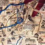 Detail of the Red Sea on the Hereford Mappa Mundi. The Red Sea is drawn with red ink and is bisected at one side by a brown path that shows the wandering of the H