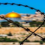 Dome of the Rock view through barbed wire